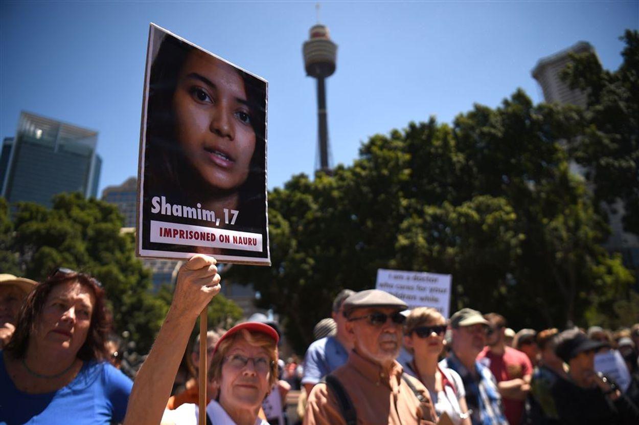 Afbeelding van Australië schikt zaak van asielzoekers tegen regering